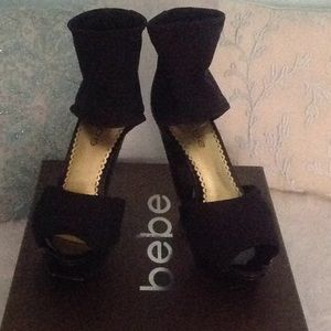 Bebe platform heels black stretch material size 5